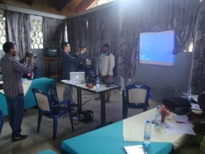 Professor Corey Takahashi demonstrating the use of certain ICT tools to participants